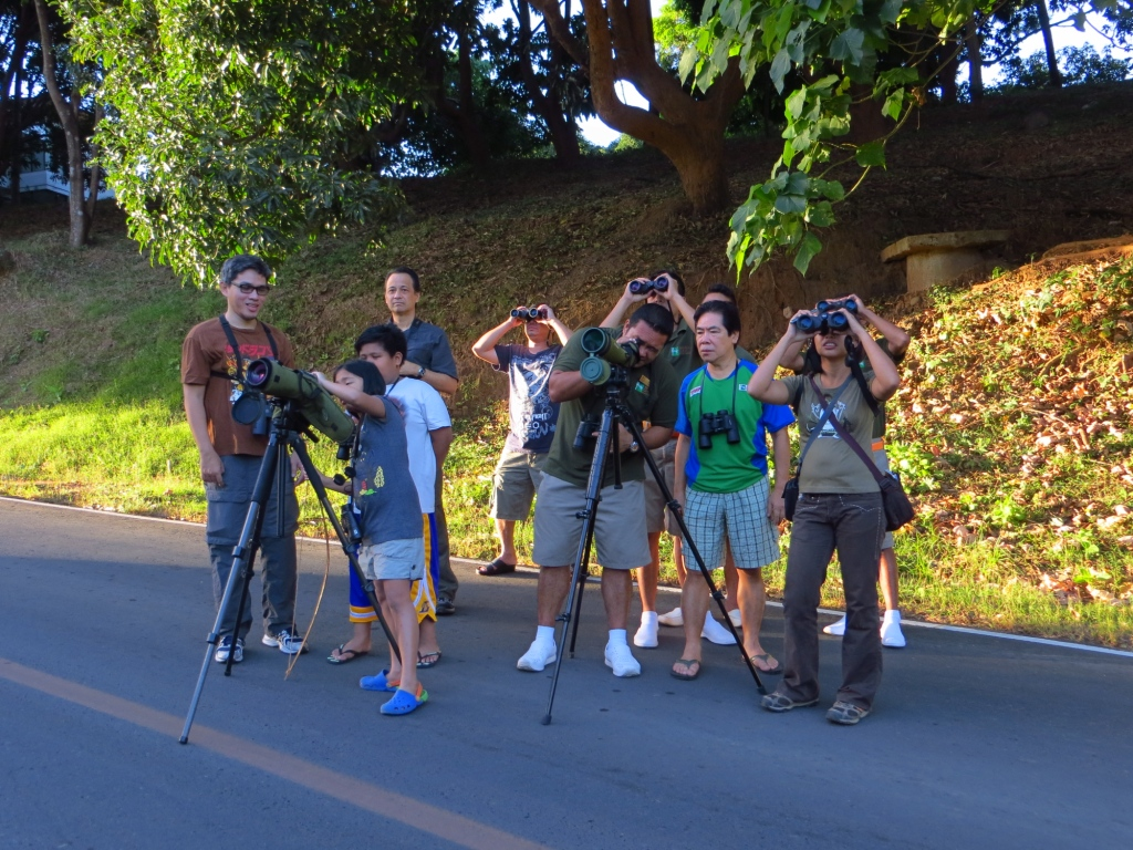Guides and participants spotting birds. Photo by Joni Acay.