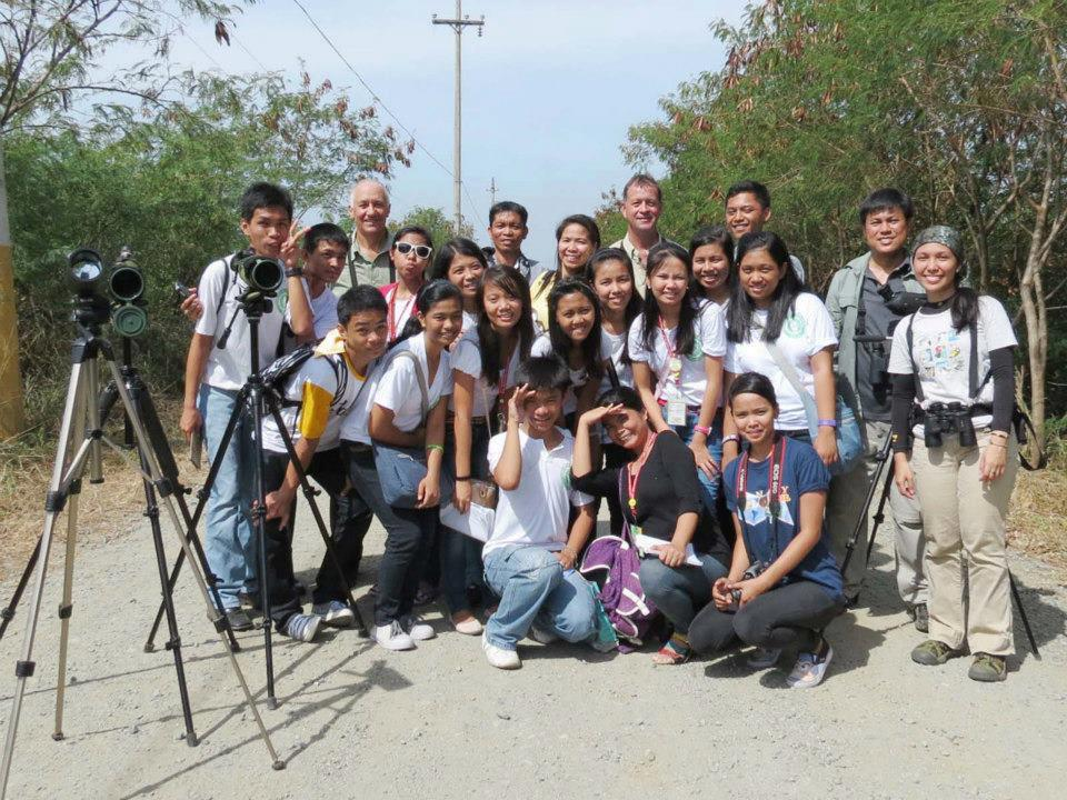 Guided morning birdwatching for students at LLPCHEA. Photo by Jasmin Meren.
