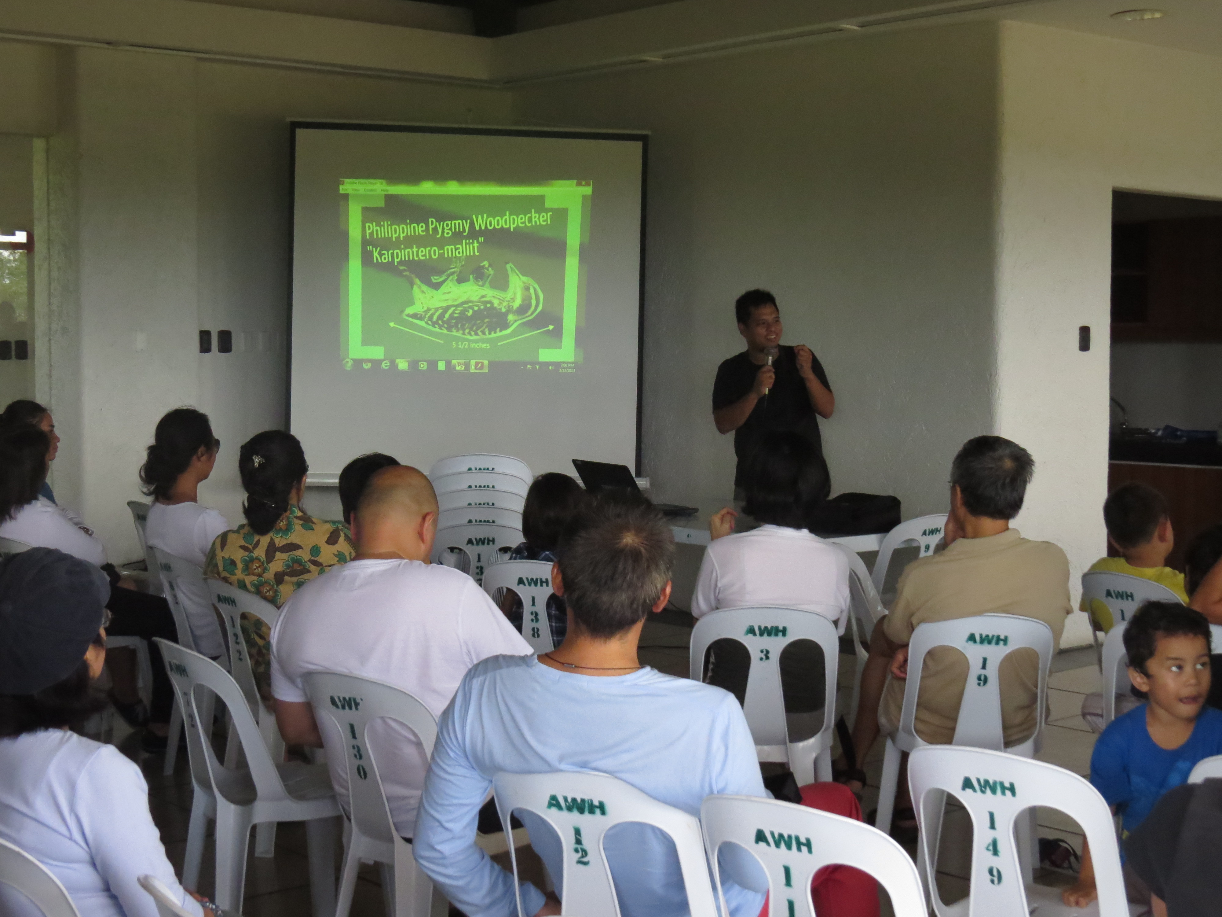 Jops Josef gives an introductory talk about some of the birds that can be seen in the neighborhood. Photo by Maia Tanedo.
