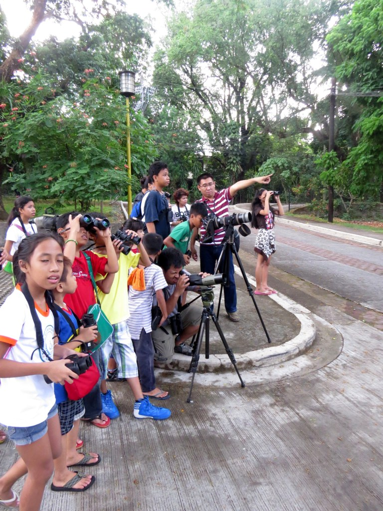 Birding with the children under He Cares Foundation. Photo by Maia Tanedo.
