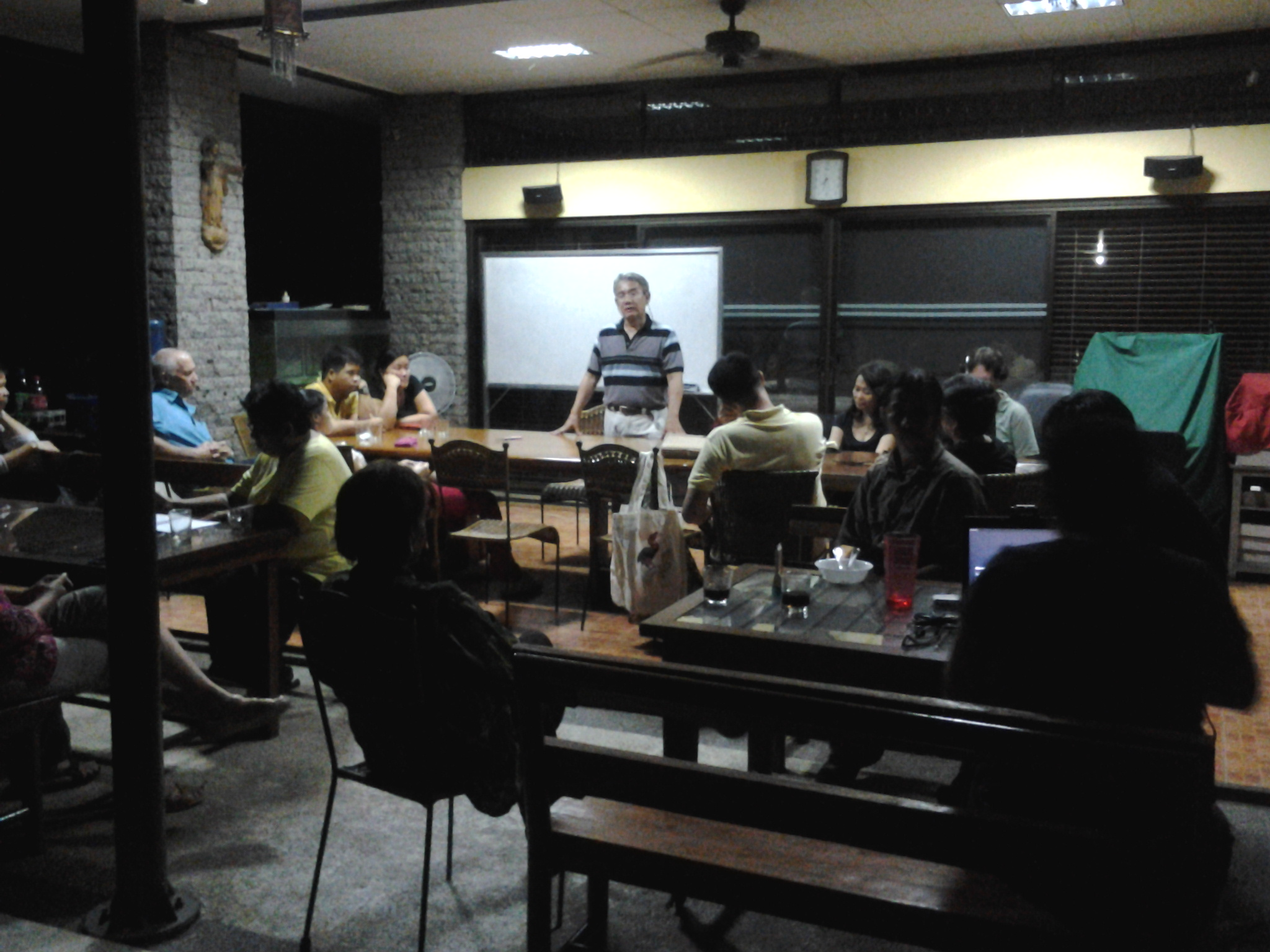 Alex Tiongco leads the discussion about raptor watch and the upcoming Raptor Lecture in August. Photo by Maia Tanedo.