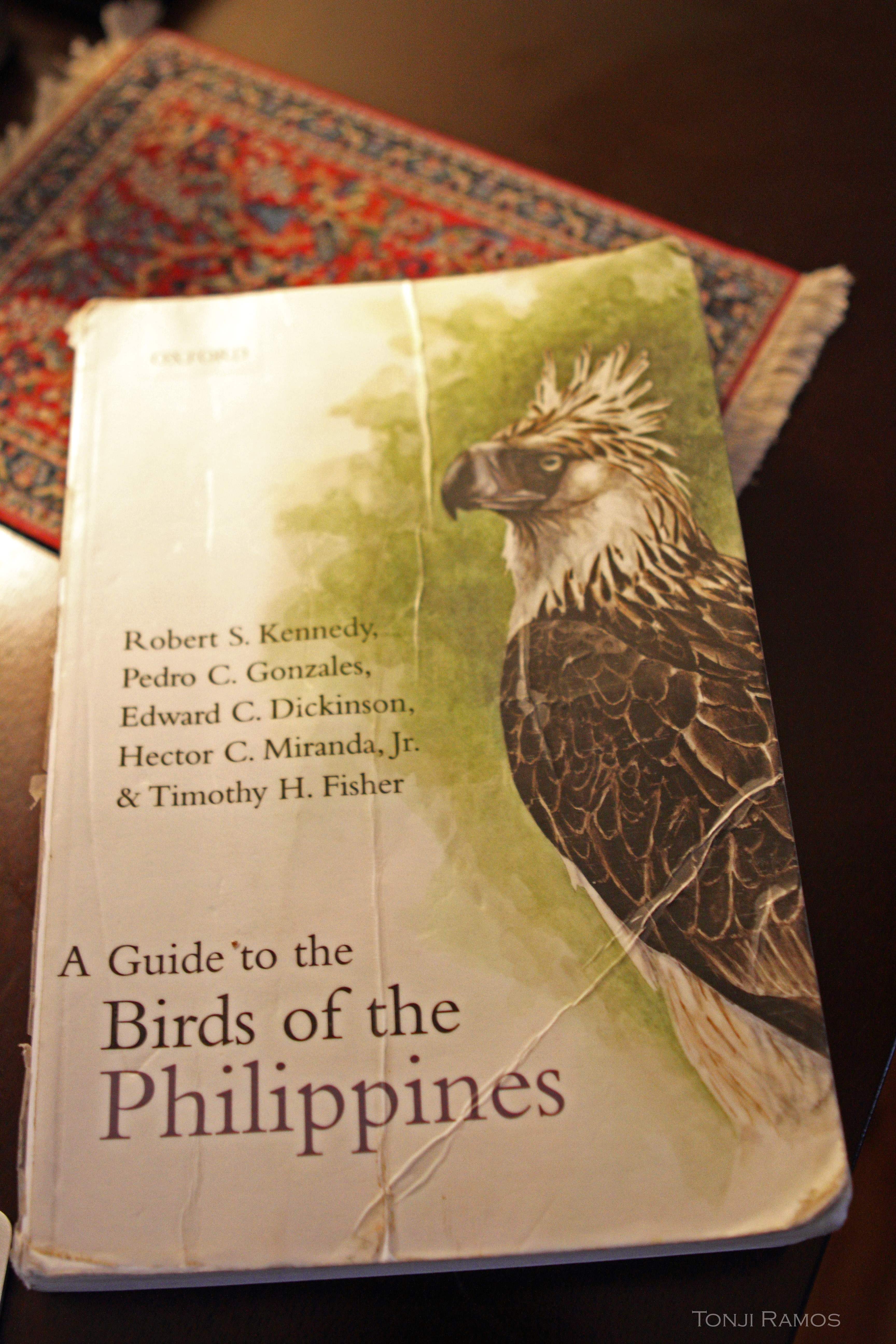 "Travel weary copy of ""A Guide to the Birds of the Philippines"". Photo by Tonji Ramos."