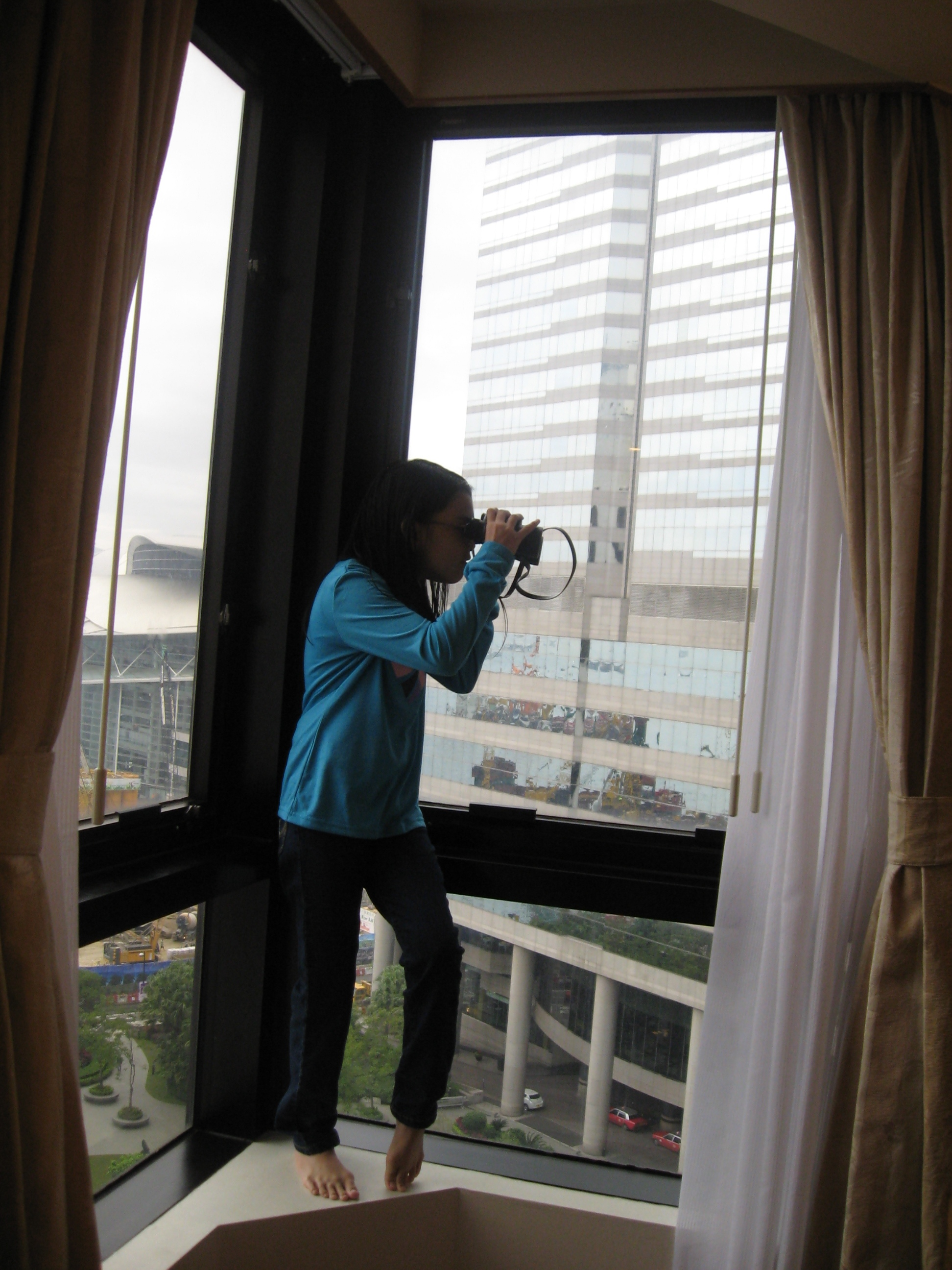 Looking for Black Kites from a hotel window in Hong Kong.