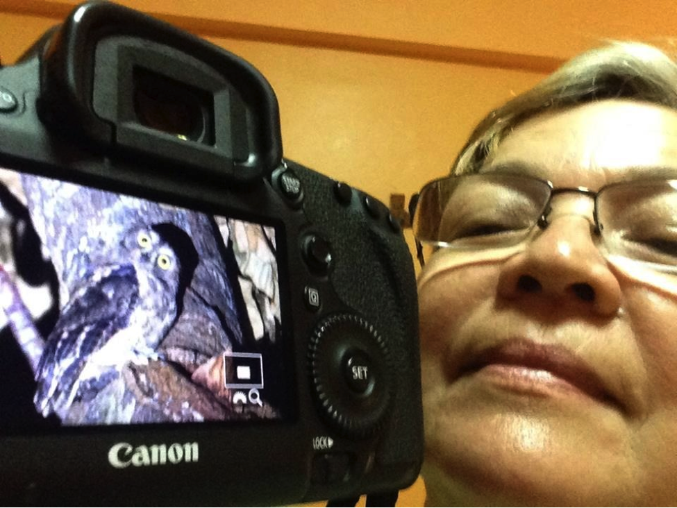 One of the 7 Stooges, Ixi showing off her photo of the Ryukyu Scops Owl. Photo selfie by Ixi Mapua.