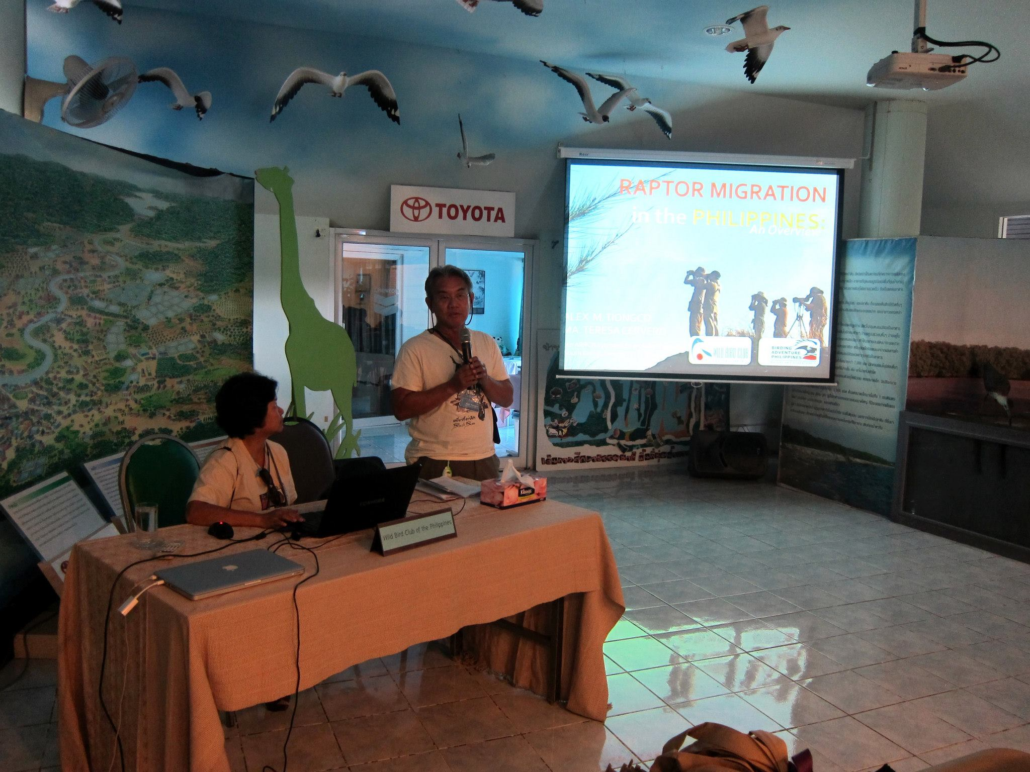 Tere (seated) and Alex do a presentation on Raptor Migration in the Philippines. Photo from Tere Cervero