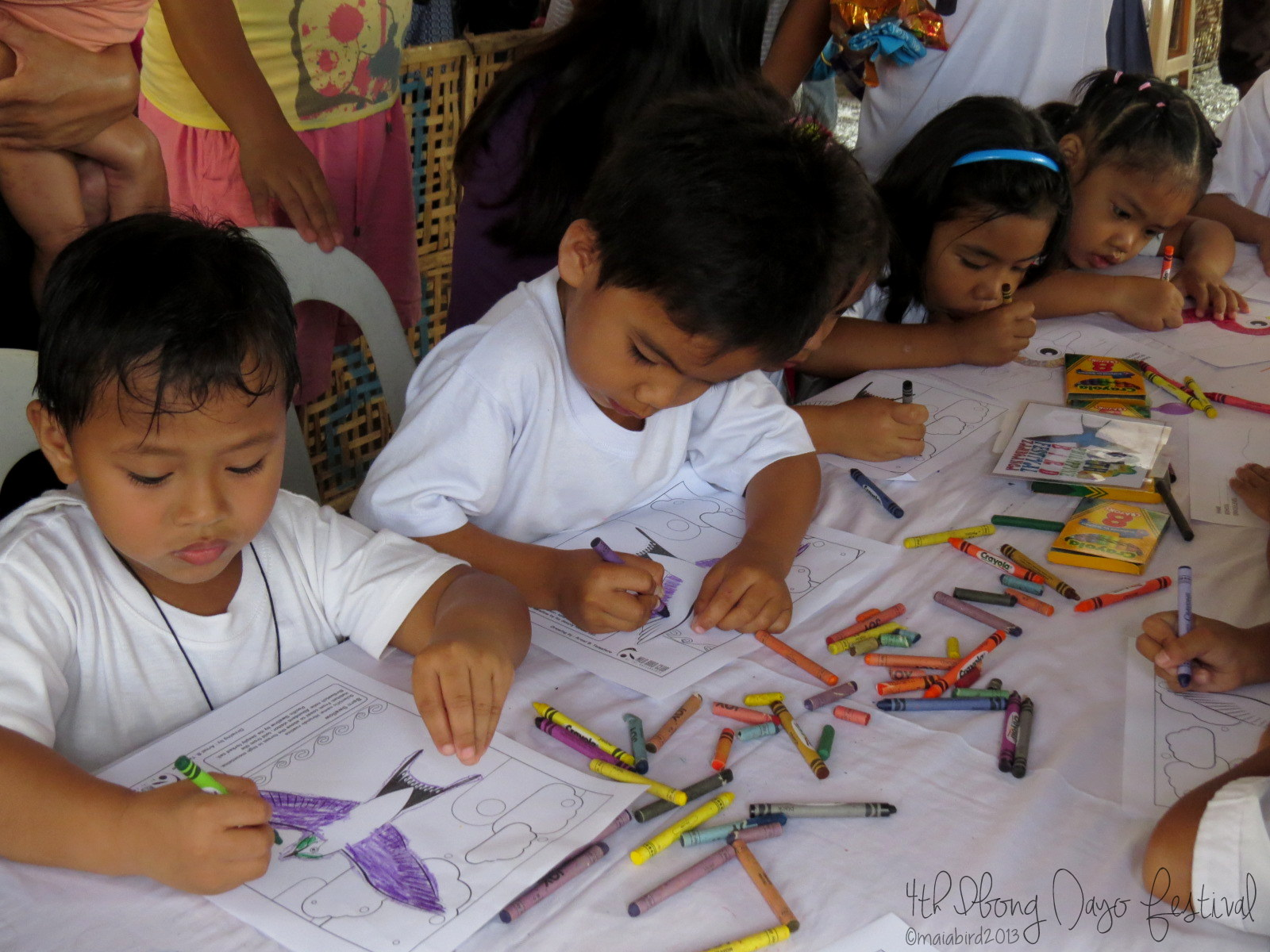 Lots of young artists flocked to the coloring booth. Photo by Maia Tanedo