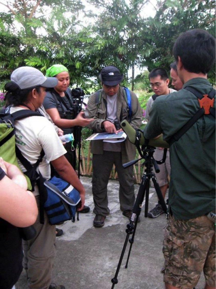 WBCP members serious during an annual Asian Waterbird Census. Photo by Maia Tanedo.