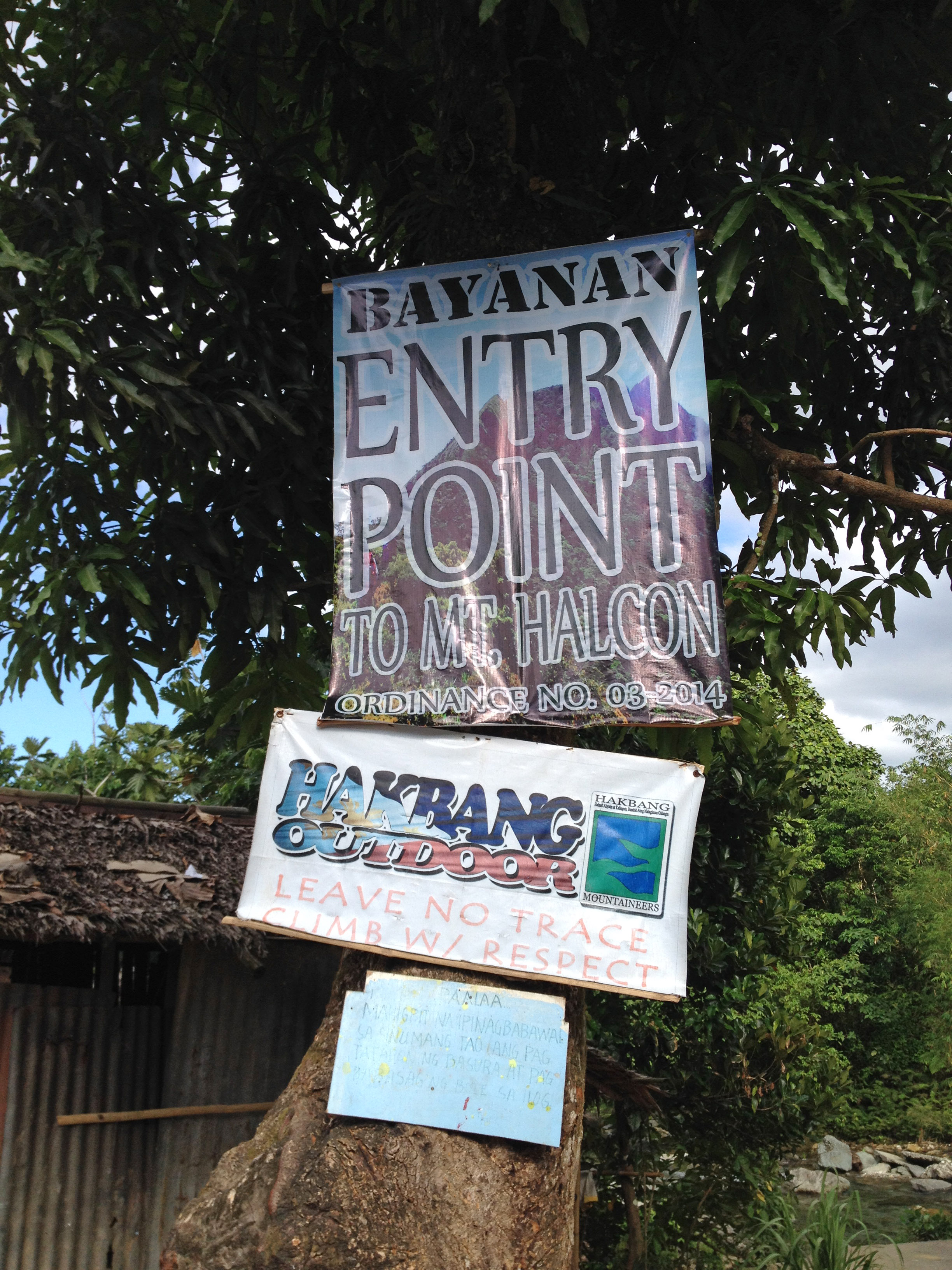 Sign at jump off Bayanan Village. Photo by Robert Hutchinson.