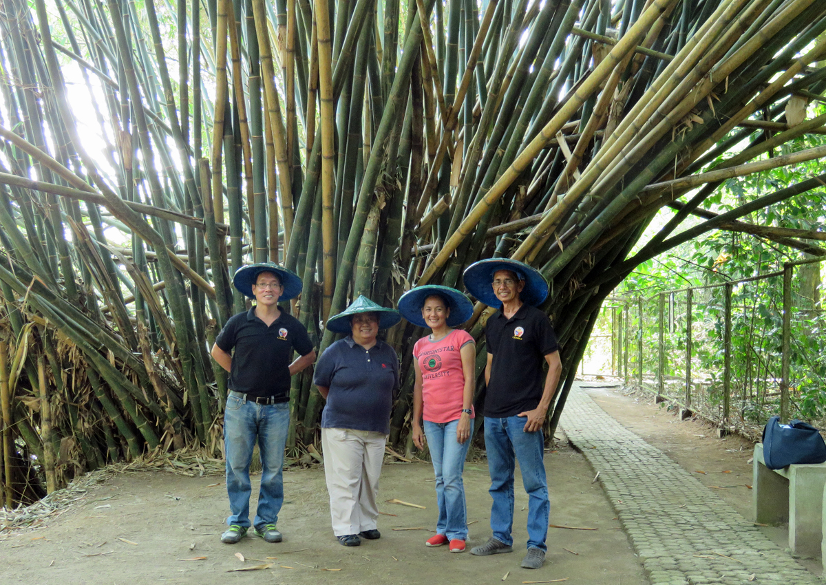 L-R: CENRO Bobby Lopez, Tinggay, Emelie, and Rey Malana. Rey's family owned the peppercorn farm that was converted into a bird sanctuary.