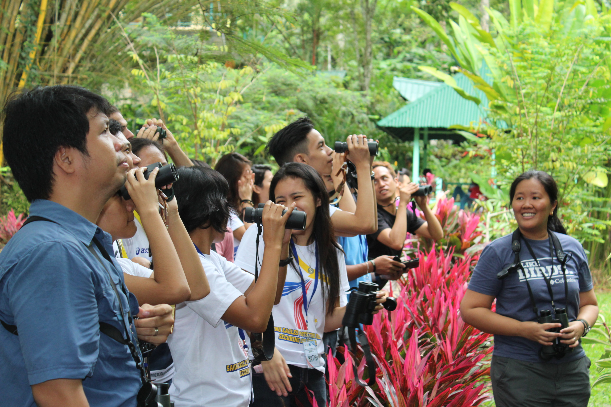 Practicing using binoculars and comparing the Yellow-vented, Yellow Wattled and Philippine Bulbuls. Photo by Trinket Constantino.