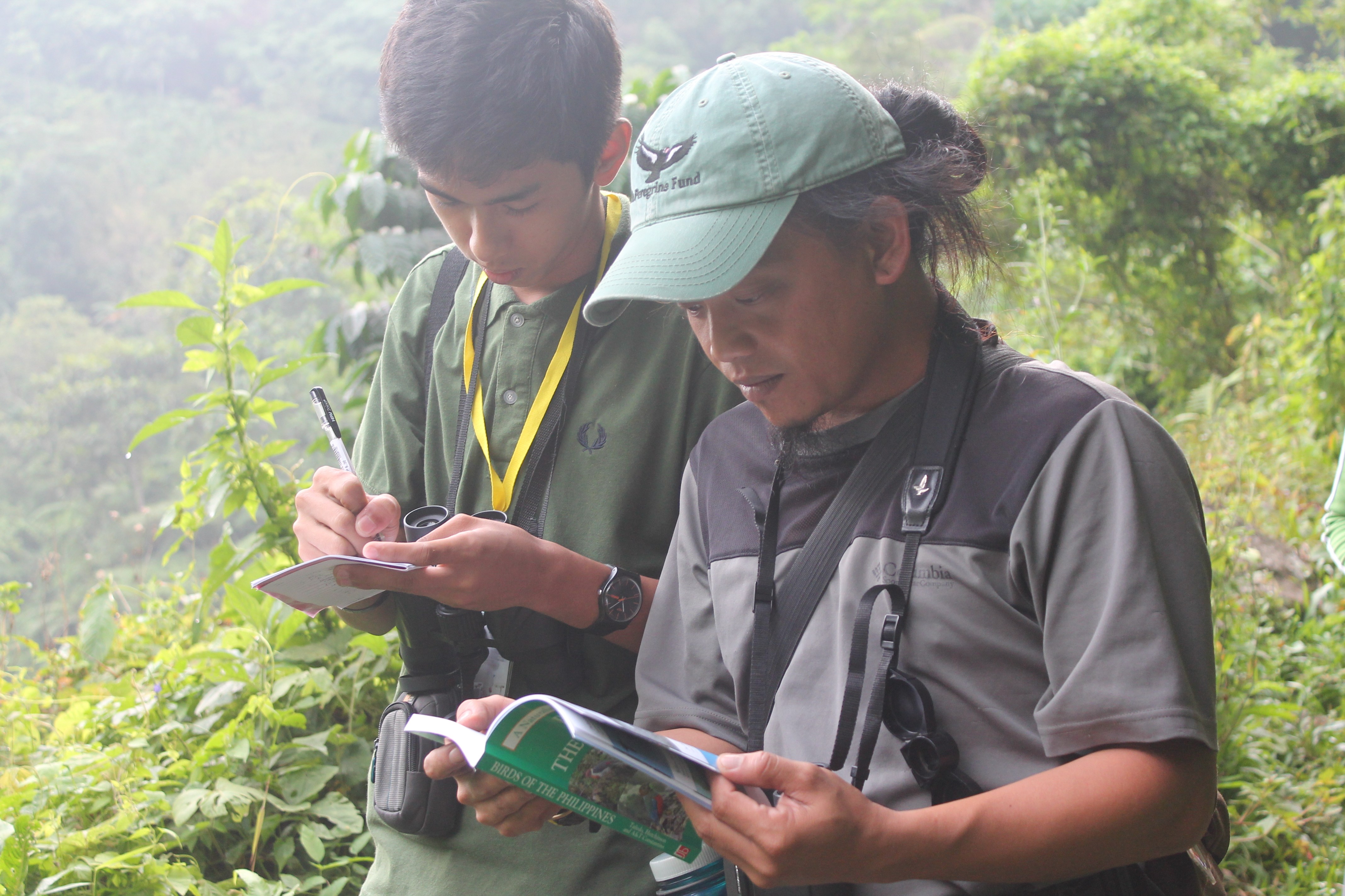 Practicing good habits: taking down notes and checking the guide book. Photo by Trinket Constantino.