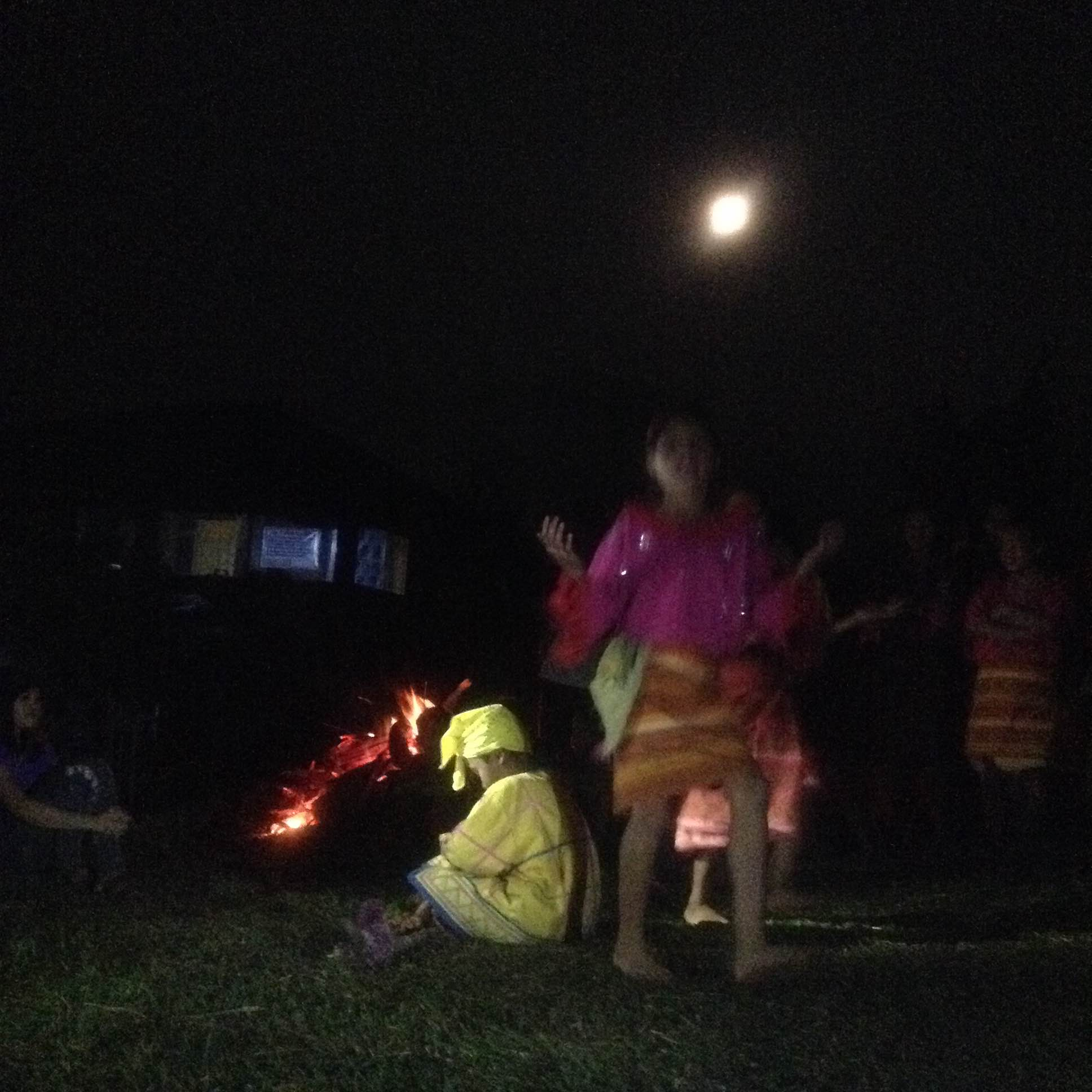 Community exchange before dinner: the children gave a delightful performance under a full moon. Photo by Trinket Constantino.
