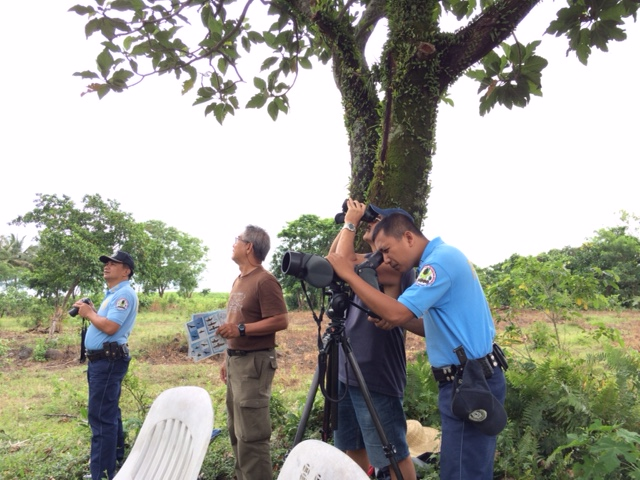 The Chief of Police of Pagudpud and his team watching raptors for the first time